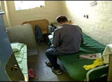 Young offender in prison cell