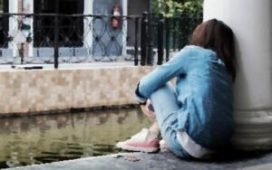 Lonely Woman sits outside